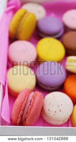 Colorful macaroons in box, closeup