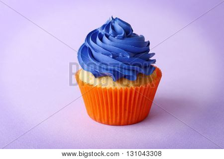 Birthday cupcake on purple background