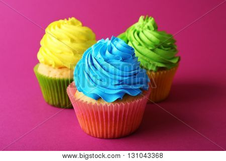 Birthday cupcakes on pink background