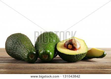 Fresh avocado on the table isolated on white