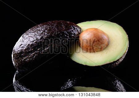 Fresh avocado on black background