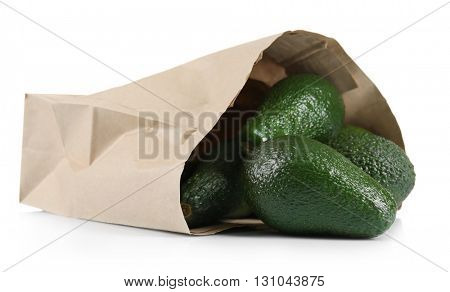 Fresh avocados in paper bag isolated on white