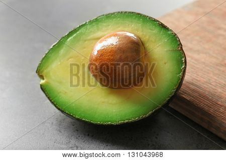 Avocado on cutting board, closeup