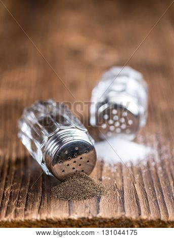 Salt And Pepper Shaker On Wooden Background