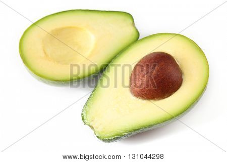 Halves of fresh avocado isolated on white