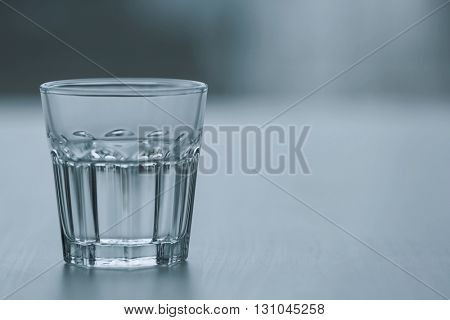 Glass of pure water on blurred background