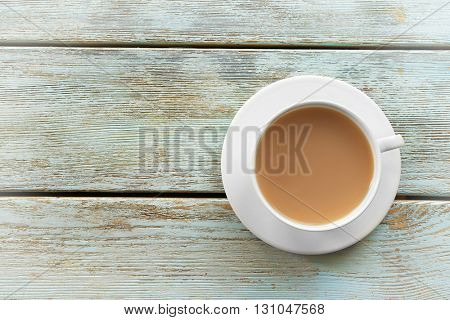 Milk tea on white rustic background.