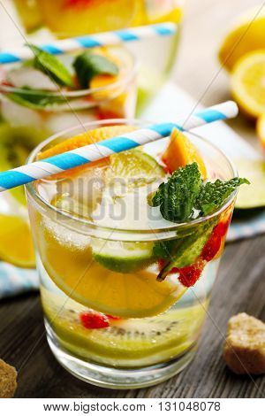 Refreshing cocktail with ice, mint, pomegranate seeds and slices of fruits