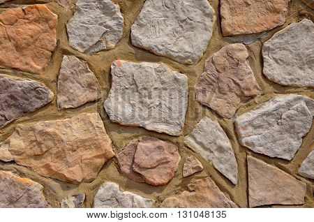 Colorful stone rock wall.  Graphic resource background or backdrop.