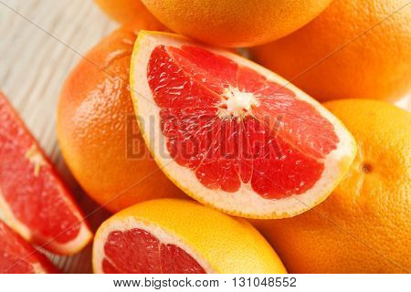 Juicy grapefruits on wooden background, close up
