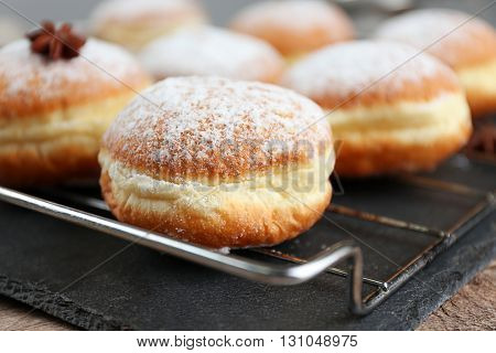 Fresh homemade donuts with powdered sugar, close up