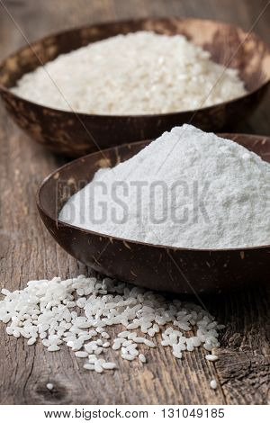 rice flour in a wooden bowl rice on the old wooden background