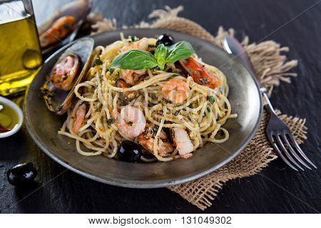 Detail of spaghetti with tomato sauce. Italian cuisine,