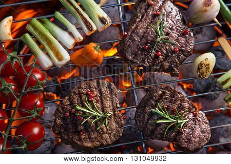 Assorted delicious beef meat with vegetable on a barbecue grill.