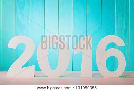 2016 some white wooden block numbers on blue wooden background