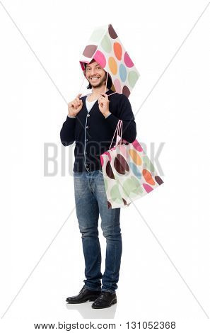 Young man holding plastic bags isolated on white