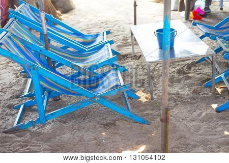 beach blue chairs at Cha-Am beach Thailand