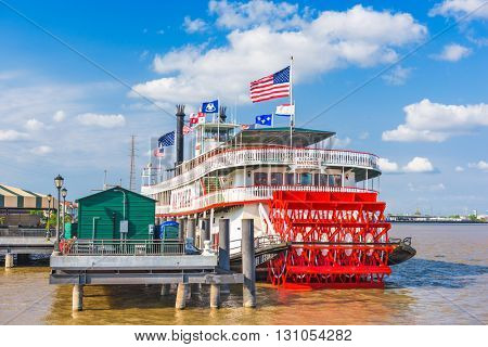 NEW ORLEANS, LOUISIANA - MAY 10, 2016: The steamboat Natchez on the Mississippi River.