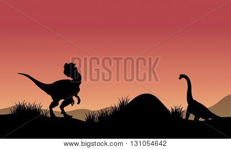Silhouette of Brachiosaurus and Dilophosaurus at the morning