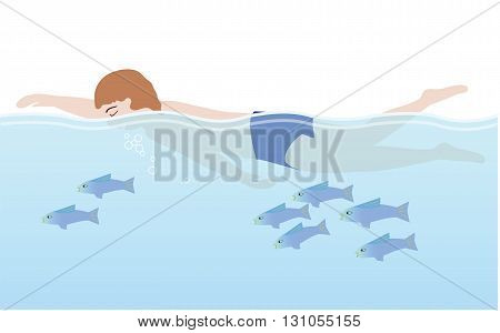 A man in swimming trunks swims with fish in a relaxed manner