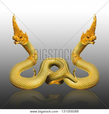 Naga Thai statue on gray background with shadow
