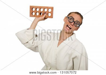 Funny woman in kimono with brick on white