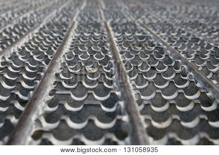 Gray metal grate, a study in pattern and texture