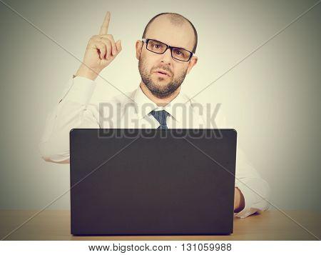 Portrait Of Businessman Pointing Finger Up
