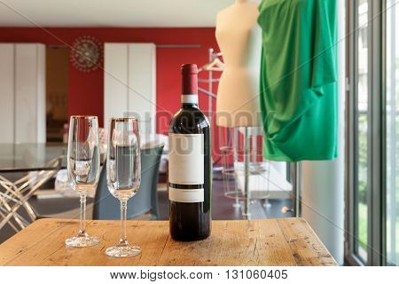 bottle of wine with two glasses, aperitif in the atelier
