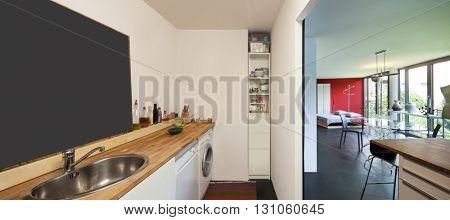 Interior of a studio apartment, washing machine and dishwasher