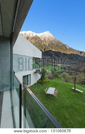 Garden of a mountain house, view from balcony