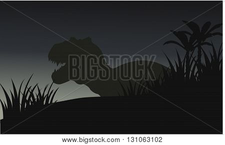 Silhouette of big tyranosaurus with grass and blue backgrounds