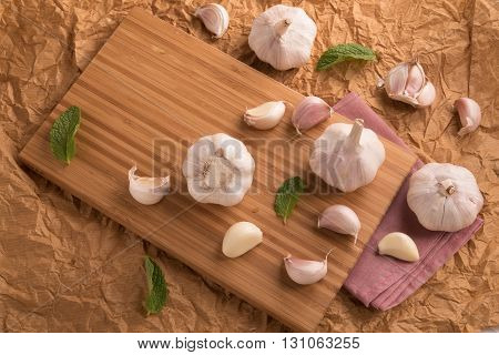 White onion on wooden panel top view