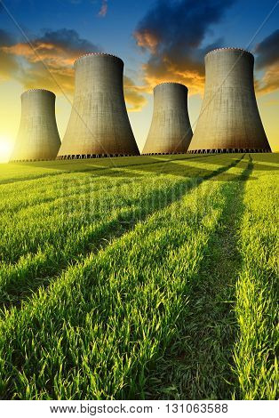 Nuclear power plant with wheat field in the sunset