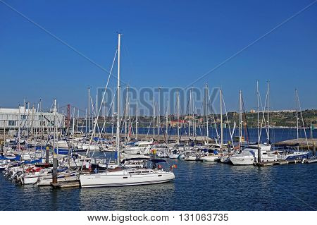 LISBON, PORTUGAL: JUNE 17, 2015: Boats and yachts parked at port of Belem during a hot summer day