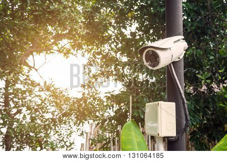 Security camera with bright sunlight, selective focus