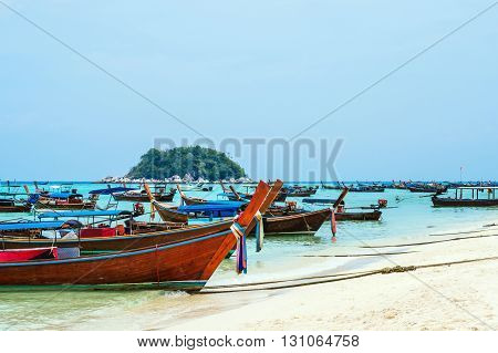 Passenger boats parked on the beach in Lipe island, Thailand