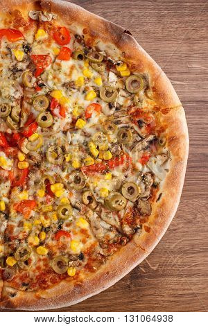 Fresh baked vegetarian pizza with vegetable on rustic wooden background italian cuisine fast food