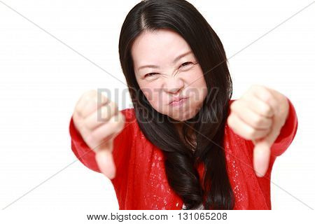portrait of woman with thumbs down gesture