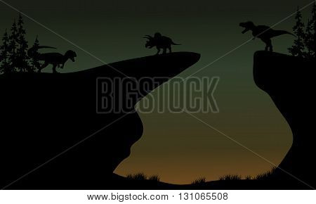 Silhouette of Triceratops and Allosaurus in the cliff