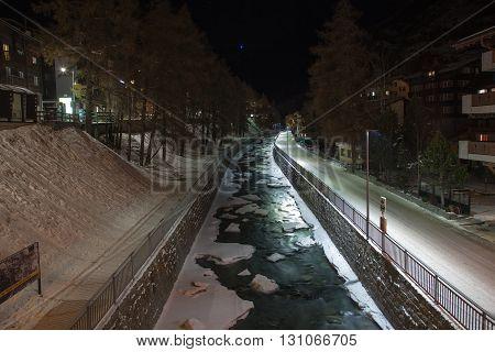 Scenic night time views of Zermatt (and frozen river) Switzerland
