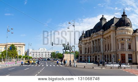 Bucharest, Romania, May 7, 2016: Central University Library and King Carol's statue in Bucharest