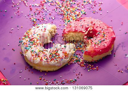 Donuts on color background.