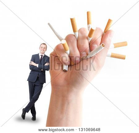 A hand crushing cigarettes and a happy businessman