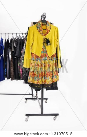 Variety of casual female clothes of different coat on hangers