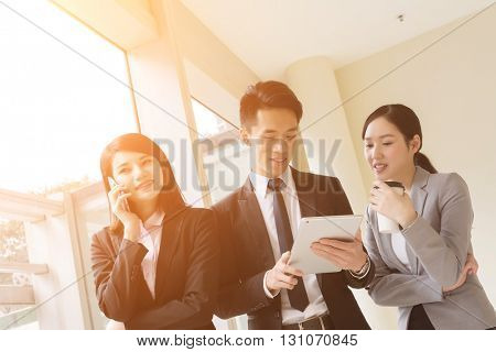 Group of business people work together with pad