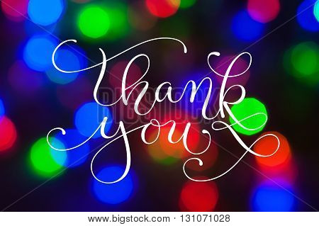 Colorful bokeh background for greeting or christmas card  with words thank you