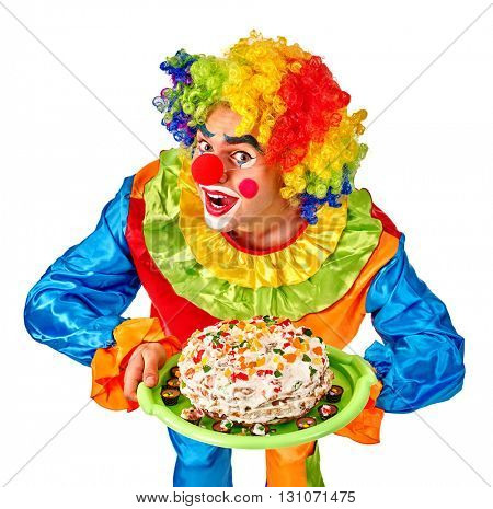 Happy birthday wig funny clown keeps cake.  Isolated.
