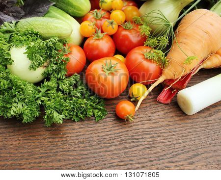 Group of fresh vegetables on wooden background