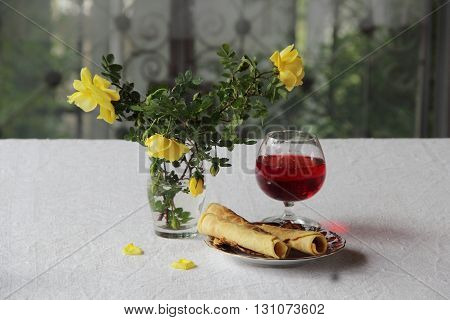 crispy waffles and a bouquet of roses and red wine